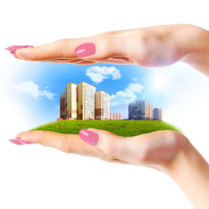 25292353 - new buildings in woman hands  on white background